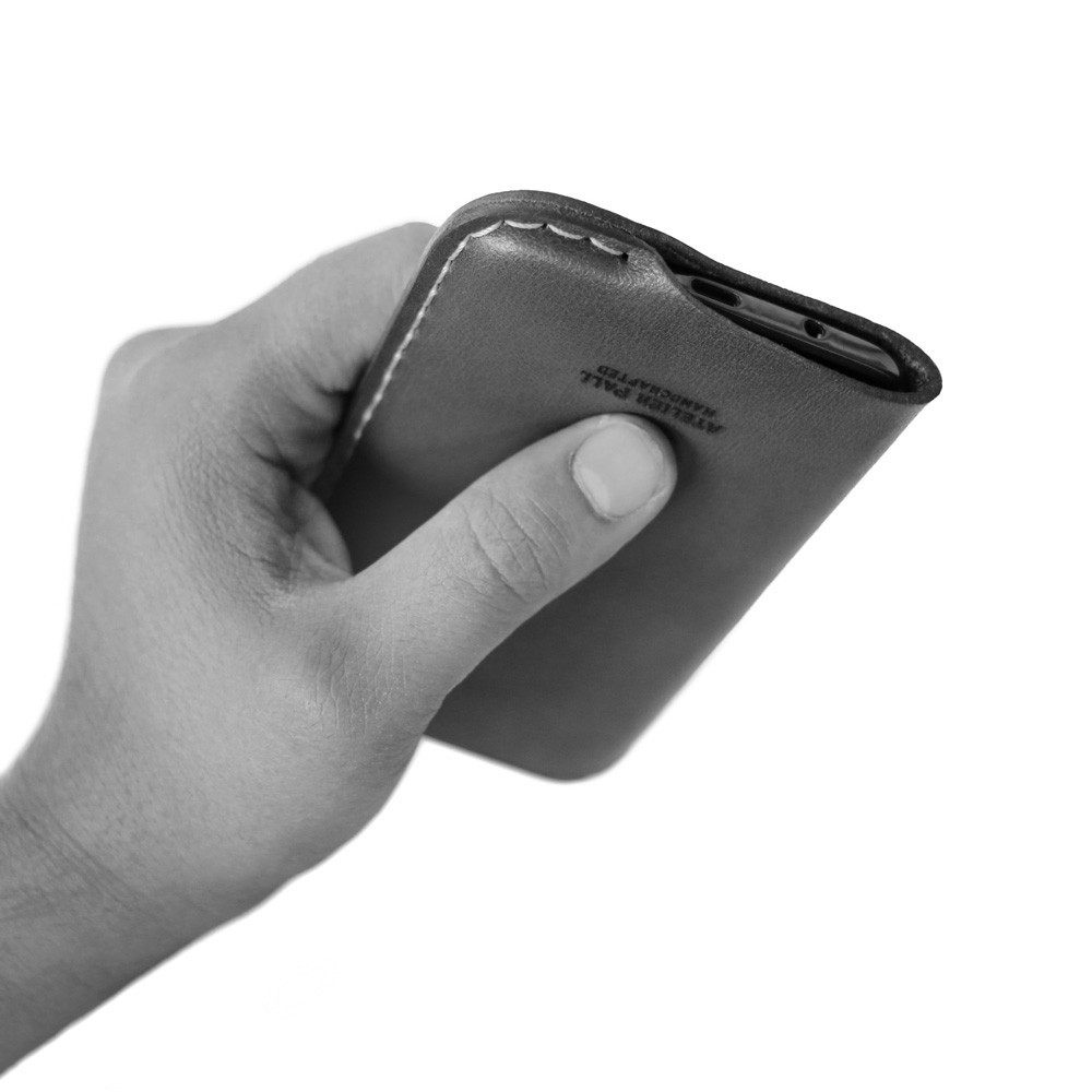 iPhone leather sleeve in hand
